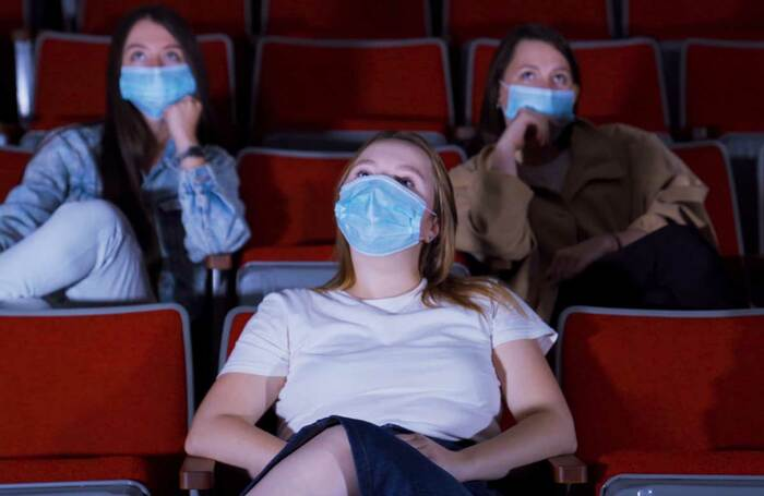 Audience members wearing facemasks. Photo: Shutterstock