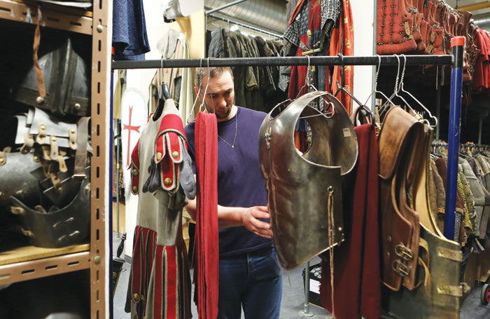 For television and film, sets of costumes are selected and put together on racks