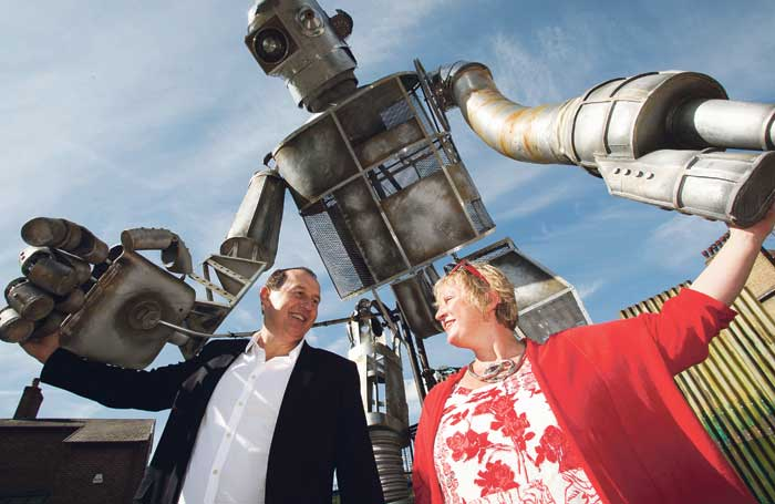 Bradley Hemmings and Jenny Sealey with the Iron Man at the 2011 Greenwich and Docklands International Festival festival. Photo: LOCOG