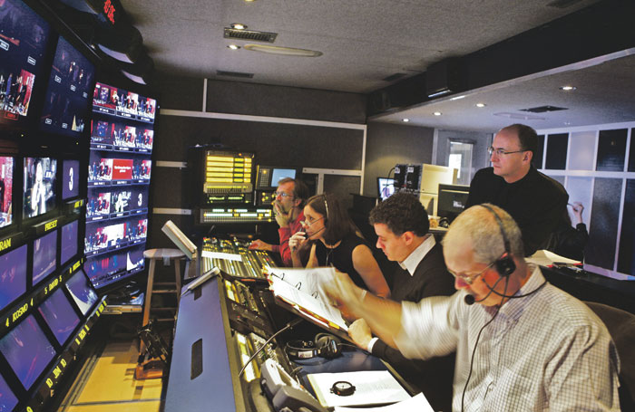 Gelb monitors the live recording of Salome from the control room. Photo:  Ken Howard