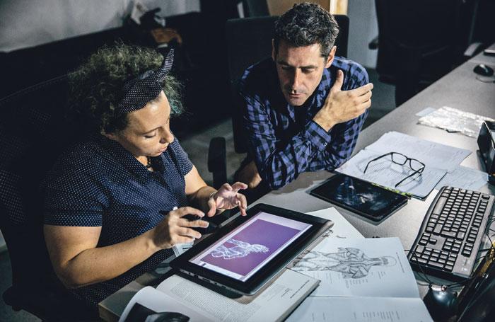Silvia Bartoli (designer at Imaginarium Studios) and Stephen Brimson Lewis (RSC production designer) looking at designs. Photo: Gramafilm